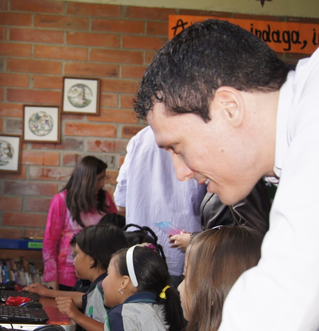 Michael Puscar donating computers to a local Colombian school (Image: Puscar)