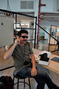 Ron Miller trying on Google Glass in New York City. With sun glasses attachment.