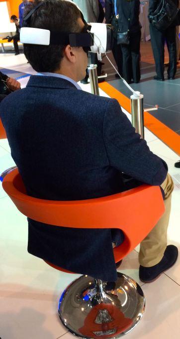 Man wearing virtual reality glasses at Mobile World Congress 2015.