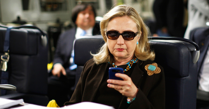 FILE - In this Oct. 18, 2011, file photo, then-Secretary of State Hillary Rodham Clinton checks her Blackberry from a desk inside a C-17 military plane upon her departure from Malta, in the Mediterranean Sea, bound for Tripoli, Libya. Clinton used a personal email account during her time as secretary of state, rather than a government-issued email address, potentially hampering efforts to archive official government documents required by law. Clinton's office said nothing was illegal or improper about her use of the non-government account and that she believed her business emails to State Department and other .gov accounts would be archived in accordance with government rules. (AP Photo/Kevin Lamarque, Pool, File)