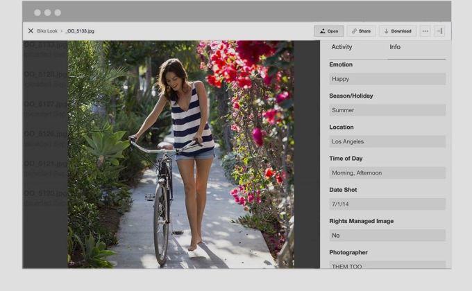 Picture of woman pushing bike through garden with metadata information next to it.