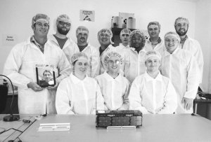 Spire team with one of their satellites / Image courtesy of Spire