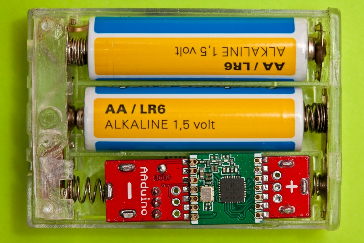 Two AA batteries and an AAduino side by side, in a display of effortless cool we haven't seen this side of Hollywood in a decade.