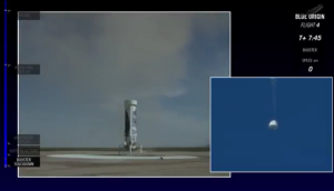 Blue Origin's New Shepard vehicle touches down as the crew capsule begins its descent / Screenshot of live Blue Origin webcast