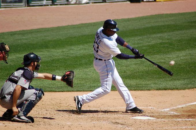 Hitting a baseball.