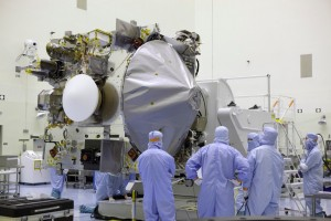 OSIRIS-REx spacecraft hoisted on a rotation stand at NASA Kennedy Space Center / Image courtesy of NASA