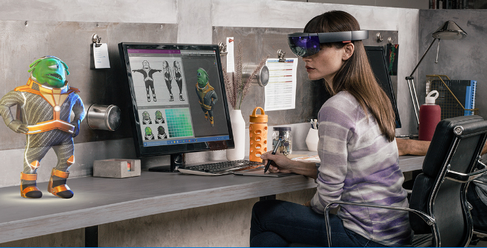 Woman working on robot design using Microsoft Hololens.