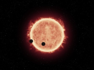Artist illustration of two of the three planets in this system orbiting their star, which is smaller and cooler than our own sun / Image courtesy of NASA/ESA/STScI/J. de Wit