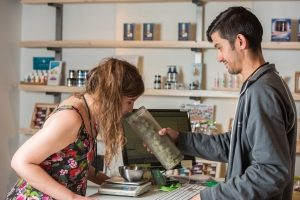 A customer considers the buds at a marijuana dispensary.