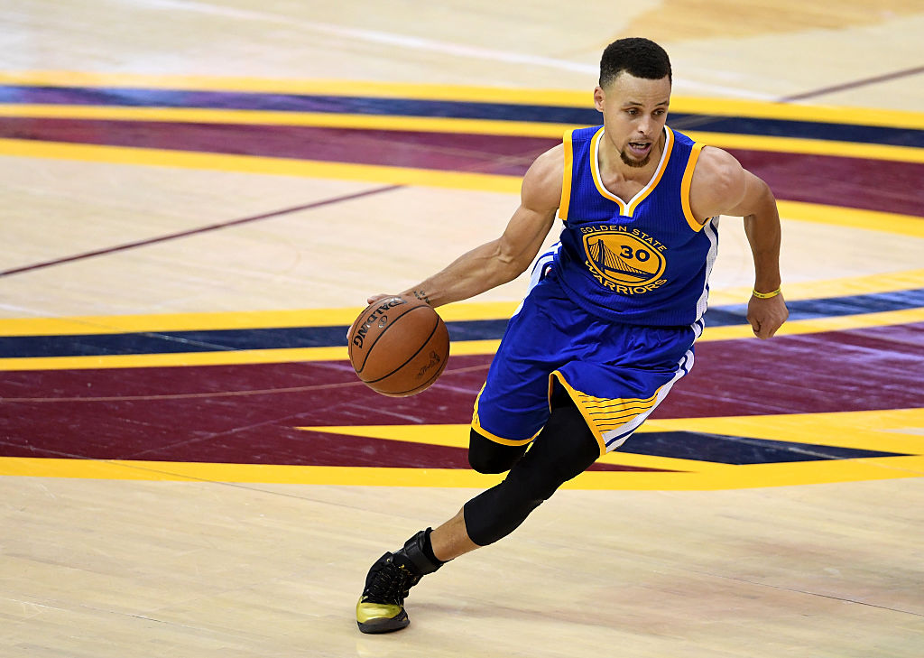 CLEVELAND, OH - JUNE 16: Stephen Curry #30 of the Golden State Warriors with the ball against the Cleveland Cavaliers in Game 6 of the 2016 NBA Finals at Quicken Loans Arena on June 16, 2016 in Cleveland, Ohio. NOTE TO USER: User expressly acknowledges and agrees that, by downloading and or using this photograph, User is consenting to the terms and conditions of the Getty Images License Agreement. (Photo by Jason Miller/Getty Images)
