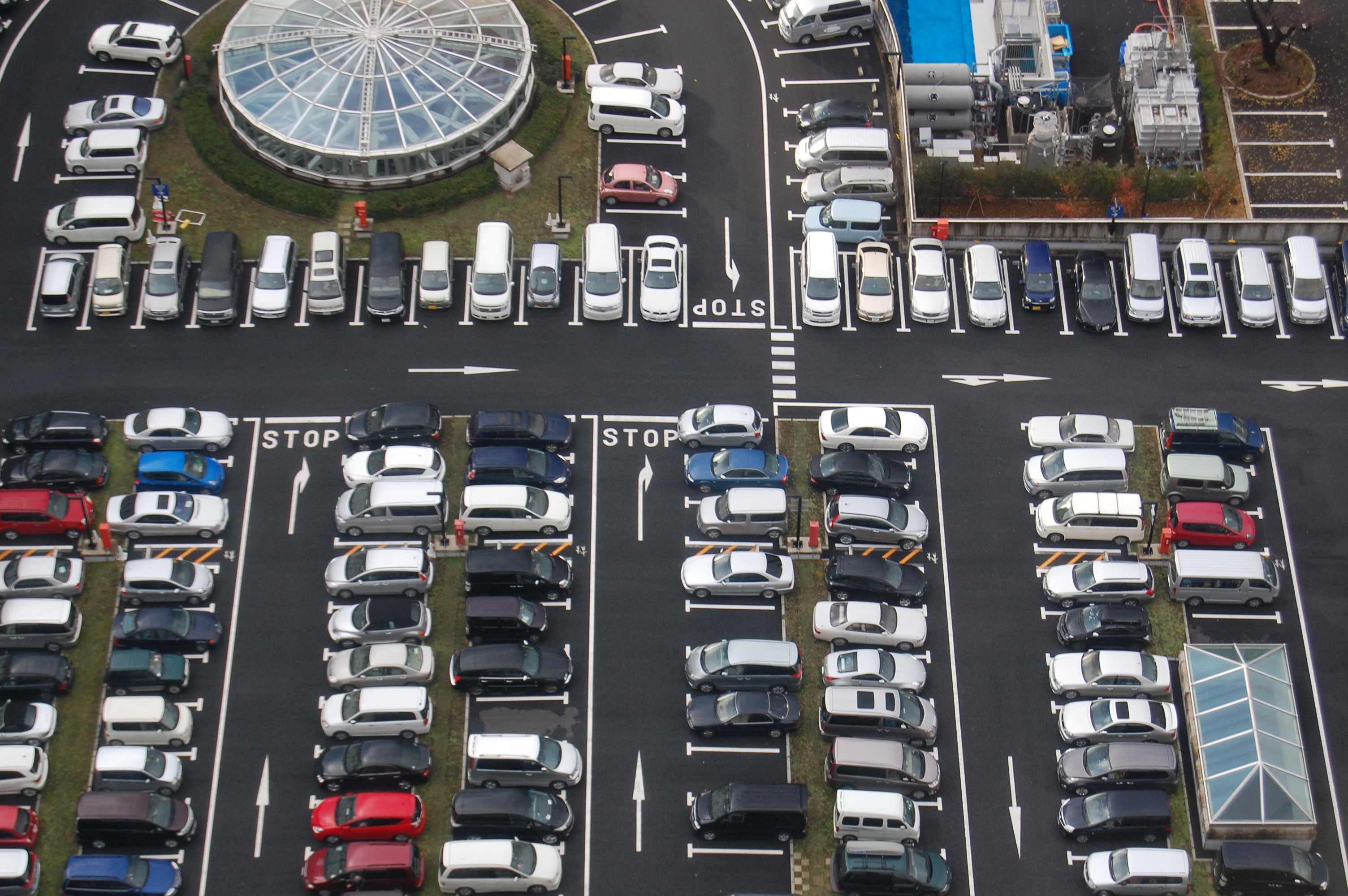 Parking lots like this one in Tokyo currently take up vast tracts of otherwise useless urban space, argues Lyft.