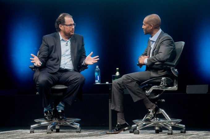 Marc Benioff, chairman and chief executive officer of Salesforce.com Inc., left, speaks with Tony Prophet, vice president of Windows marketing at Microsoft Corp., during the DreamForce Conference in San Francisco, California, U.S., on Monday, Oct. 13, 2014. Salesforce.com Inc. is entering a new business, data analytics and business intelligence, seeking to maintain growth and persuade customers to pour more of their information into its data centers. Photographer: Noah Berger/Bloomberg via Getty Images