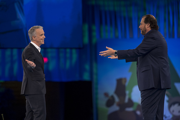 Marc Benioff, chairman and chief executive officer of Salesforce.com Inc., right, greets Parker Harris, co-founder of Salesforce.com Inc., left, during the DreamForce Conference