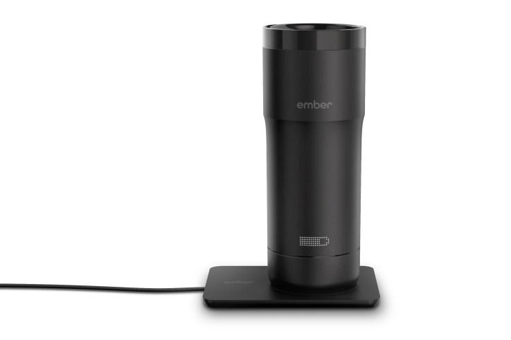 Ember temperature control mug on its charging base.
