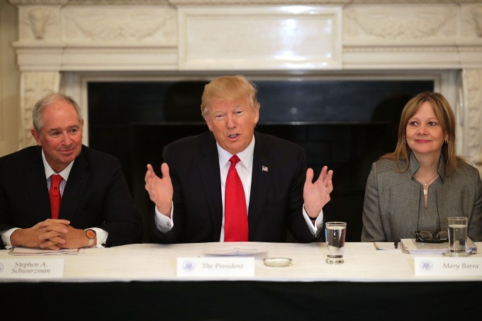 WASHINGTON, DC - FEBRUARY 03:  U.S. President Donald Trump (C) delivers opening remarks at the beginning of a policy forum with business leaders with General Motors CEO Mary Barra (R) and chaired by Blackstone Group CEO Stephen Schwarzman in the State Dining Room at the White House February 3, 2017 in Washington, DC. Leaders from the automotive and manufacturing industries, the financial and retail services and other powerful global businesses were invited to the meeting with Trump, his advisors and family.  (Photo by Chip Somodevilla/Getty Images)
