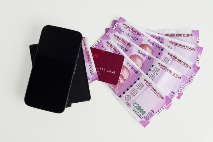 Top View of New Indian Currency Notes of 2000 With Mobile Phone, Wallet and Credit Cards