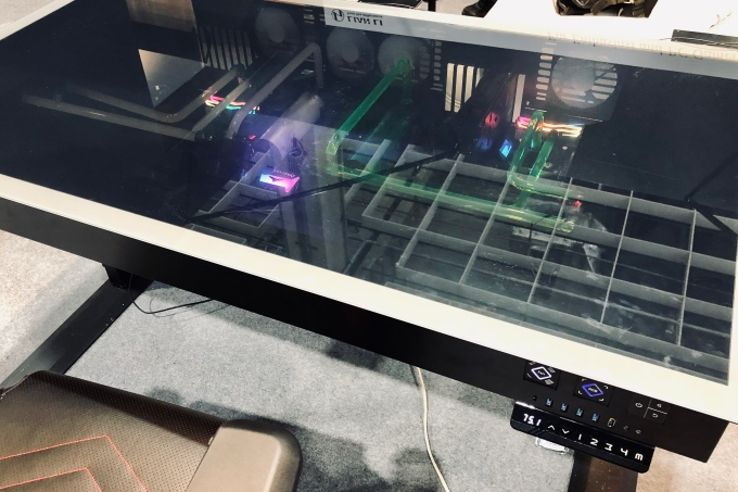 Lian Li's DK-05 workstation and chassis lets you see the interior underneath its tempered glass