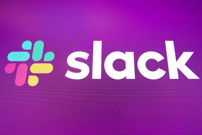 logo for Slack is displayed on the a monitor at the New York Stock Exchange