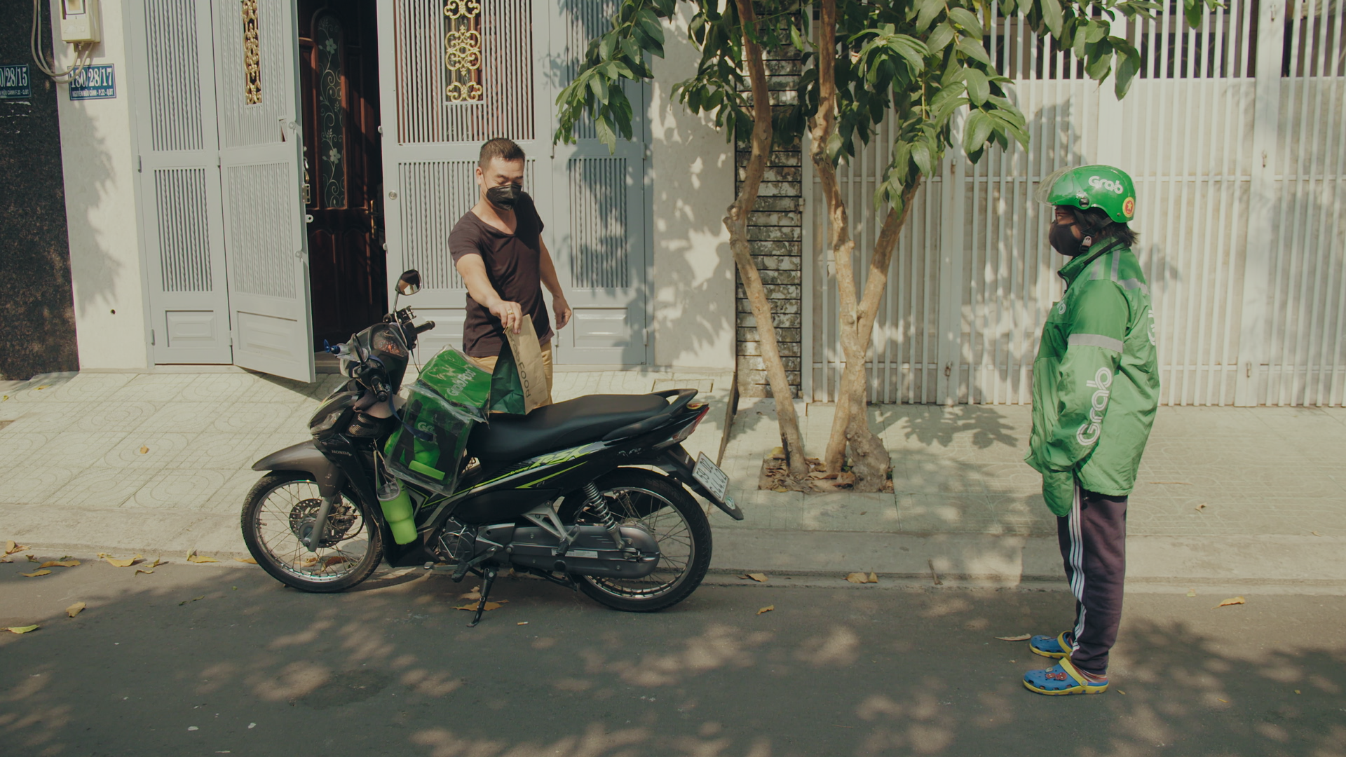 A contactless delivery performed by a Grab delivery driver