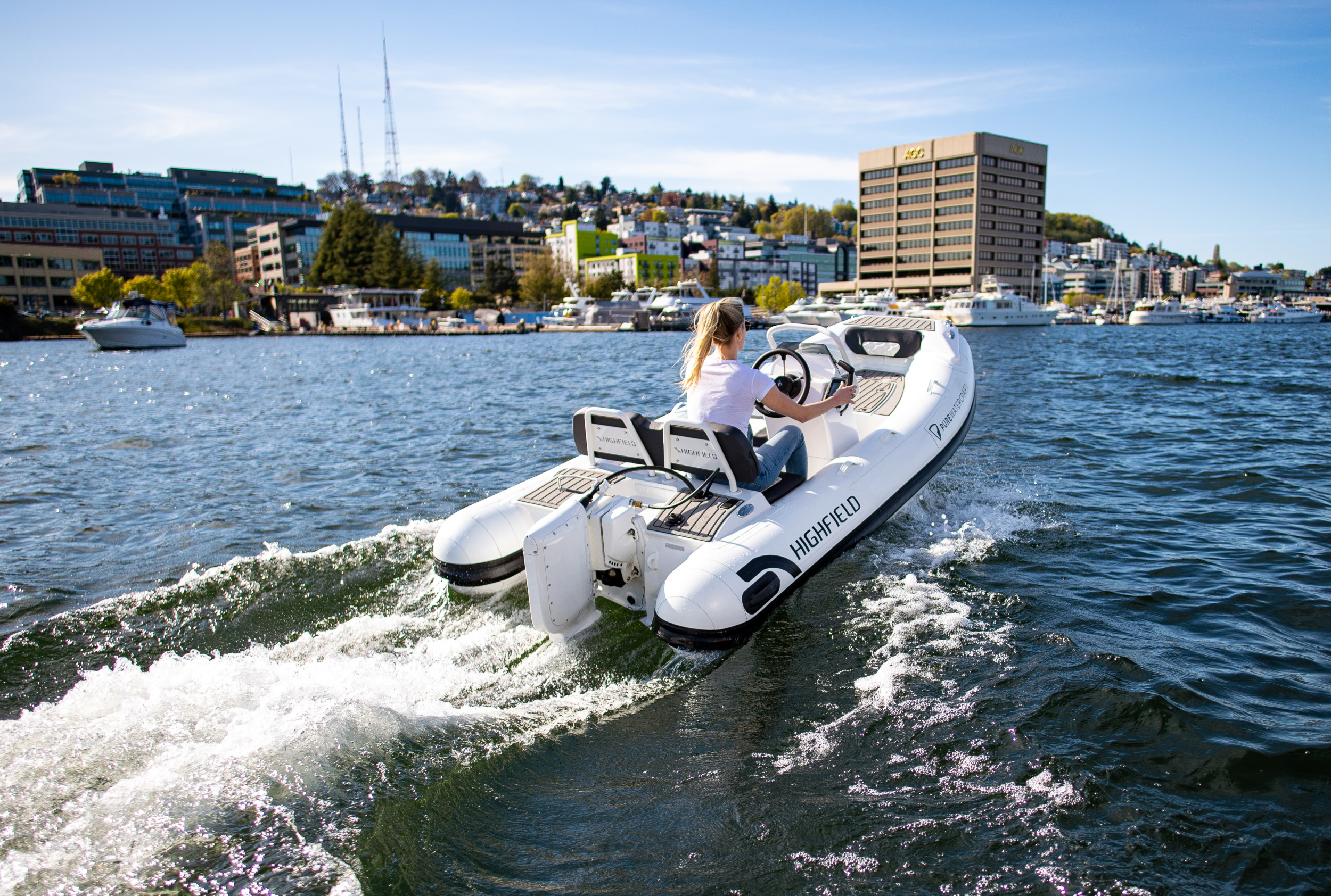 A boat with an electric outboard motor cruising on a lake.