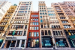 Low angle view of residential houses and shops in Tribeca, New York City, USA