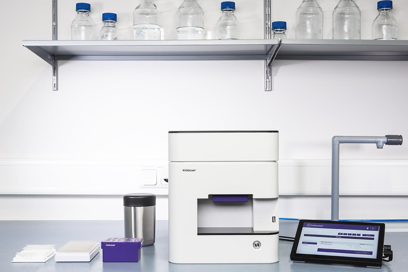 Kilobaser's DNA sequencing device on a lab bench.