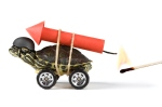 Turtle (real) with a rocket on the back, a match (real flame) is about to ignite it. No turtles were harmed in the making of this stock image.